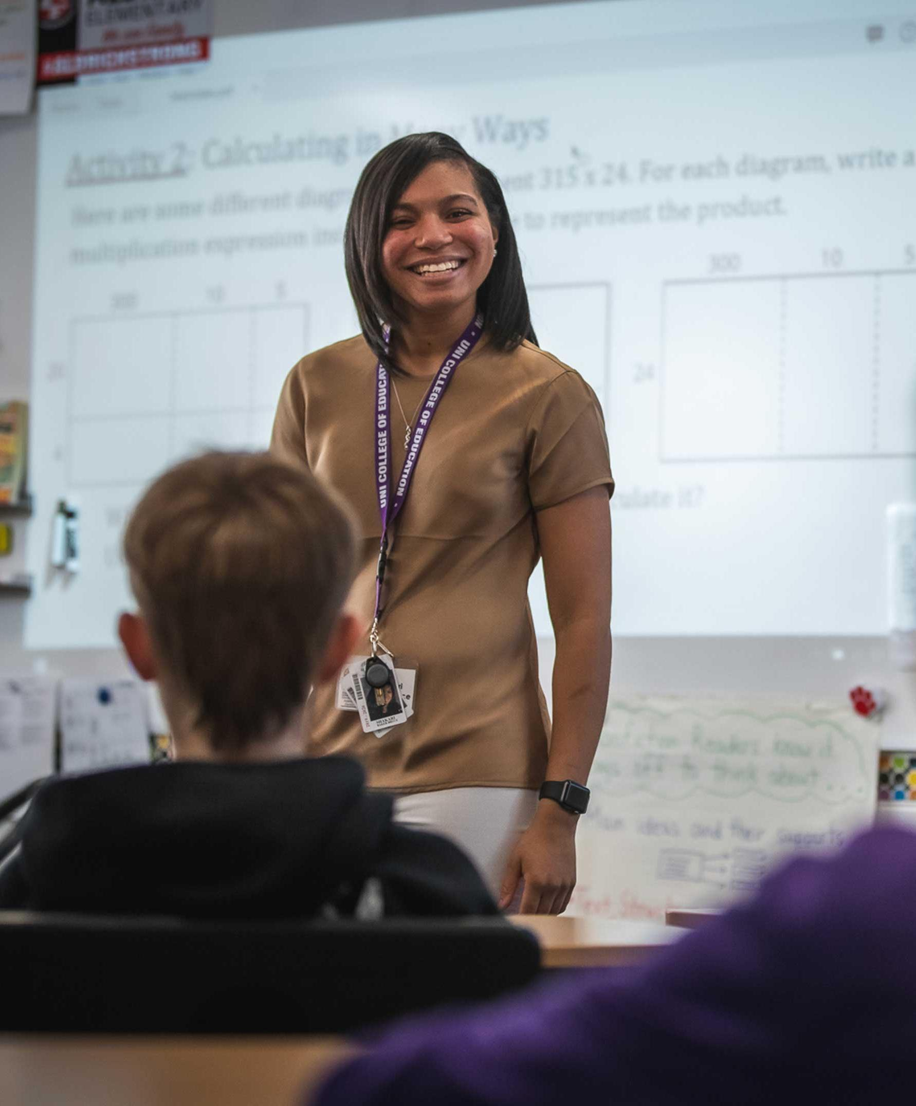 University of Northern Iowa teacher education student in front of classroom