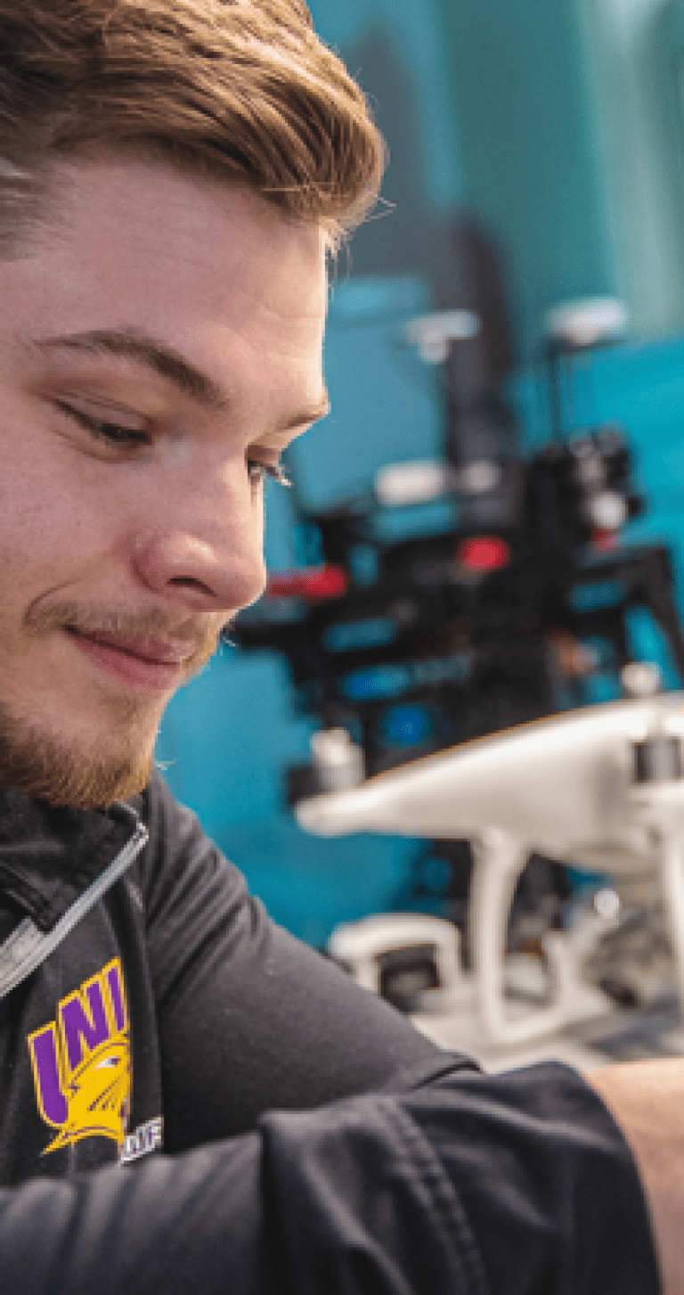 UNI student working on drone